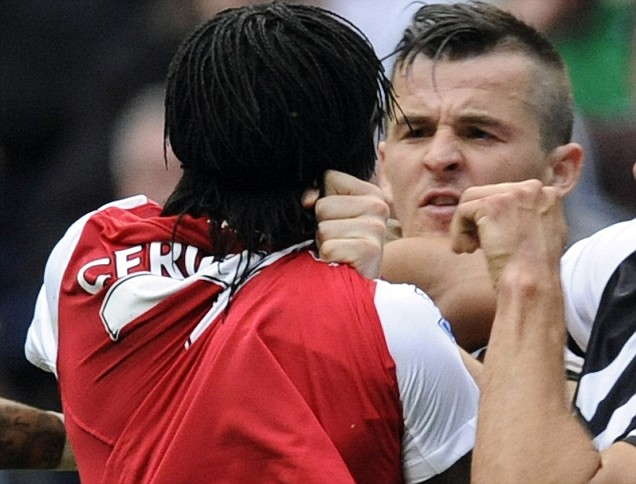 Joey Barton  confronts Arsenal's  Gervinho