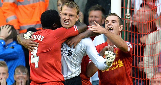 Simon Mignolet celebrates vital penalty save against Stoke City
