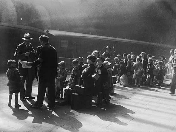 Evacuees Leave Liverpool...A group of 317 evacuee children wait at a railway station in Liverpool before travelling to safer areas, 27th August 1942. (Photo by Keystone/Hulton Archive/Getty Images)