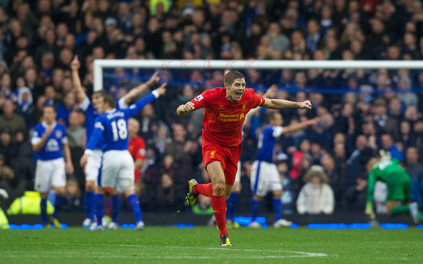 LIVERPOOL, ENGLAND - Sunday, October 28, 2012: Liverpool's captain Steven Gerrard celebrates the third goal, but it was disallowed, against Everton during the 219th Merseyside Derby match at Goodison Park. (Pic by David Rawcliffe/Propaganda)
