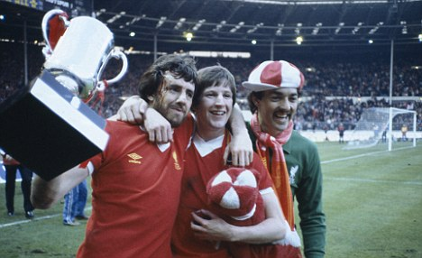 Mark Lawrenson, Ronnie Whelan, and Bruce Grobbelaar celebrate with the Milk Cup (sponsors trophy) after Liverpool had defeated Tottenham Hotspur 3-1 after extra time in the League Cup Final at Wembley Stadium, 13th March 1982. The League Cup was sponsored by the Milk Marketing Board. (Photo by Bob Thomas/Getty Images)