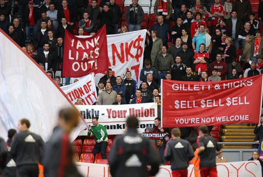 Liverpool fans protest against co-owners Tom Hicks and George Gillett in the stands after the final whistle as the Liverpool team warm down